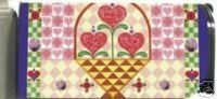 """Jim Shore Hearts Valentine's Day Magnetic Mailbox Cover by Evergreen. $9.99. Mailbox Cover may be trimmed for a custom fit.. Reuseable & pvc coated. Fits standard sized mailboxes, 6.5""""W x 19""""L. Includes a sheet of numbers.. Made of durable fade resistant vinyl and will not crack or tear.. Give your mailbox a new look for every season and reason! Magnetic mailbox covers are offered in a wide variety of unique designs that are certain to add variety and excitement to any or..."""