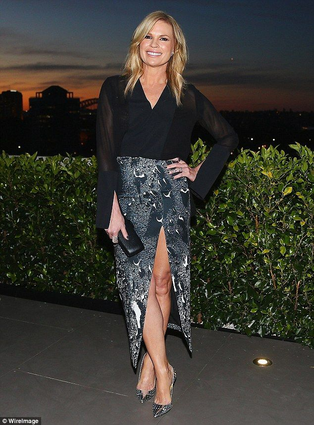 Leggy lady! Sonia Kruger wowed in a seriously split skirt at a party celebrating the launc...