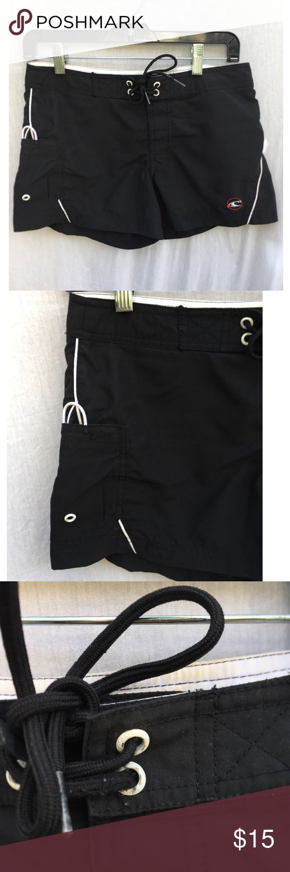 ONEILL BLACK & WHITE WOMEN'S SWIM BOARD SHORTS Size 3 with adjustable waist tie. black and white color. Oneill logo on front side. Has pockets. Good condition lightly worn no significant flaws. FREE SURPRISE GIFT WITH EVERY ORDER! O'Neill Swim