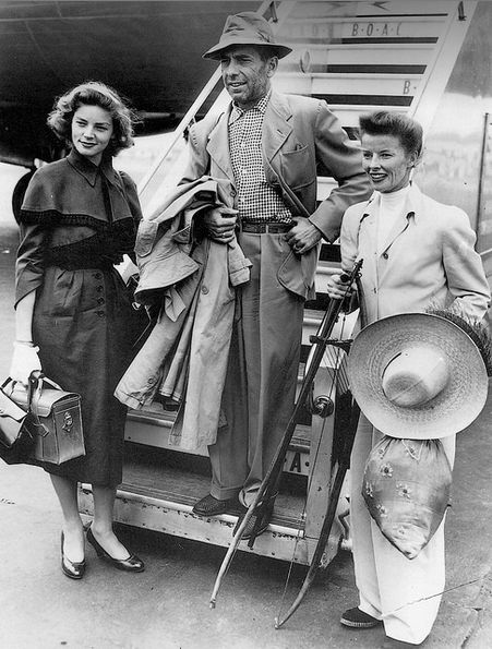 """Lauren Bacall, Humphrey Bogart, and Katharine Hepburn arriving in London after the filming of """"The African Queen"""" (1951)"""