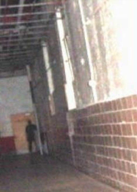 Do You Believe in Ghosts? 25 of the Most Convincing Paranormal Pictures Ever Taken - Moundsville Prison Shadow Man
