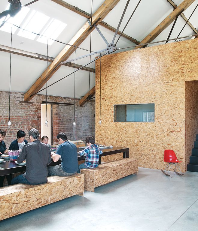 The main public space of the renovated Ochre Barn is broken up by a full-height OSB pod, which contains a bathroom and a utility room with a view. Construction-site offcuts comprise a 20-seat table, which architect Carl Turner made from a birch-core black phenolic-faced plywood, a waterproof material more commonly used to form concrete. The film-coated ply from UK supplier James Latham comes cheap, making it ideal for this kind of experimentation. Photo by Christoffer Rudquist.