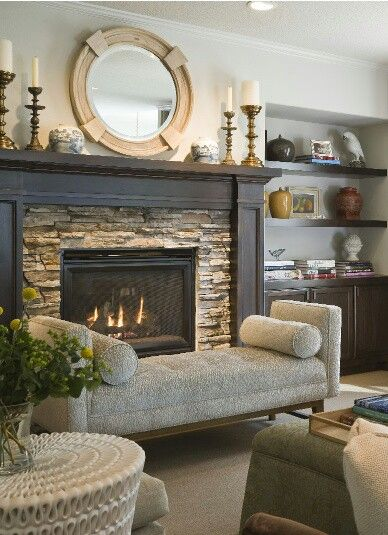 Similar stone surround with dark wood ...maybe use the same stone from outside the house?
