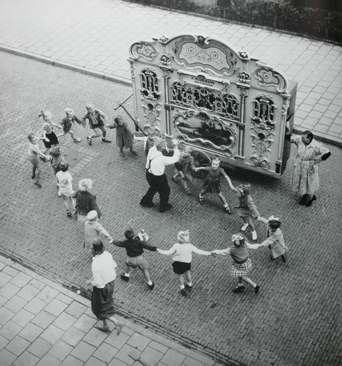 Street organ with dancing children. Amsterdam, 1950s, childhood