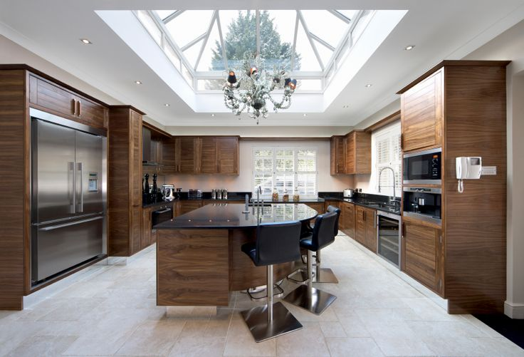 This kitchen is elegant and full of dramatic wood work. A massive skylight takes up most of the ceiling, and is the main source of light for this kitchen during the day.