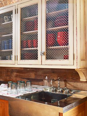Chicken wire, part of the barn vernacular, is used on cabinets—genius!