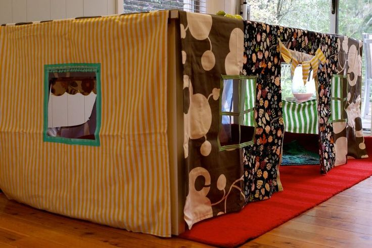 Table Fort - The kitchen table quickly morphs into something incredible with some old tablecloths and fabric! Cut a few windows out, a door, and you have a lovely place for the children to go and read, snuggle, nap, play, and anything else they can think of!