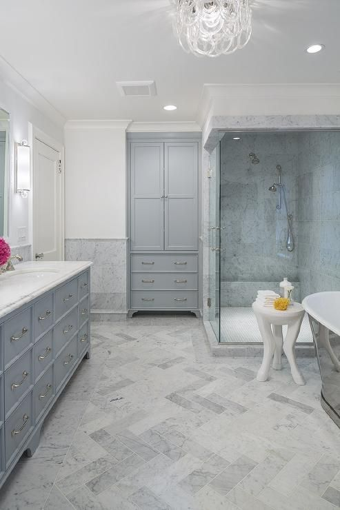 Blue and gray bathroom features a gray double vanity painted Benjamin Moore Marina Gray paired ...