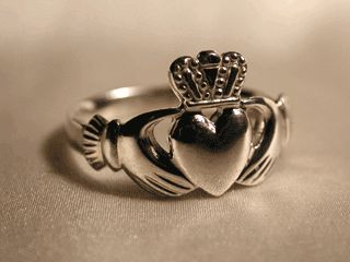 Traditional Irish Claddagh ring, symbolizing Love (heart), friendship (hands) and loyalty (crown).