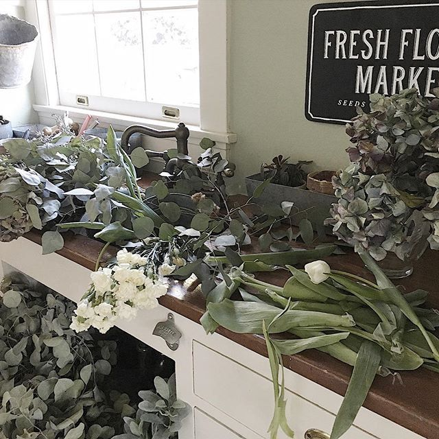 "I have been at the Long Beach Flea Market all morning. If you want to join me head on over to my stories! I think this afternoon will be spent in my flower arranging room. This is what the room looks like when I am ""at work""! I just love this new addition to our home. 💐💐💐"