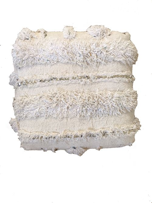 Gorgeous pouf made out of a rare white vintage wedding blanket. It's the ultimate in glamorous. The Souk by M.Montague.