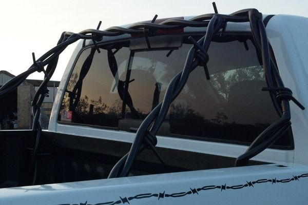 Barb Wire headache racks, side steps, grill guards and roll bars ... how sweet is that