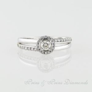 18k white gold ring with one 0.19ct KL SI round brilliant cut diamond with 33 = 0.19ct round brilliant cut diamonds micro set in the band. 1R06862