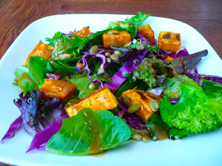 Warm yam and mixed greens salad