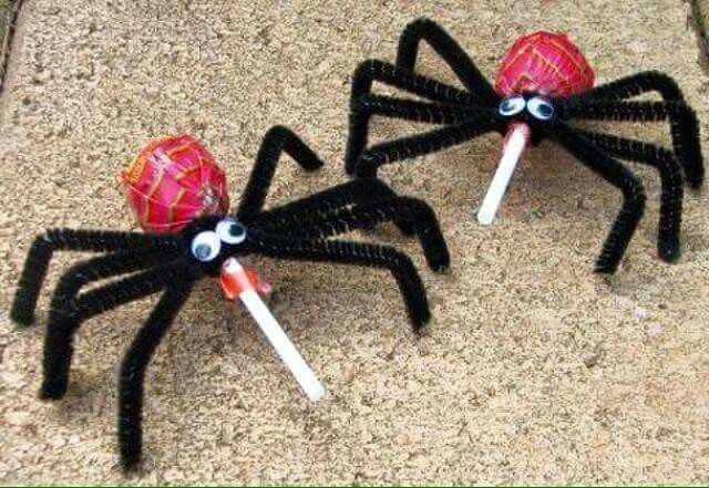 Lollypop spiders. Halloween candy suckers, pipe cleaner spiders.