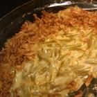 Rich Green Bean Casserole...Velveeta, cream of chicken soup and cajun seasoning.  You will never use another recipe again!!!