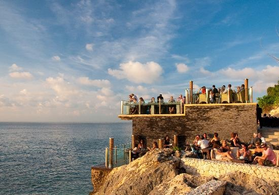 P erched atop distinctive rock formations along Jimbaran's pristine sunset coast, Rock Bar Bali is widely respected as one of the globe's most popular sunset, cocktail and entertainment venues.