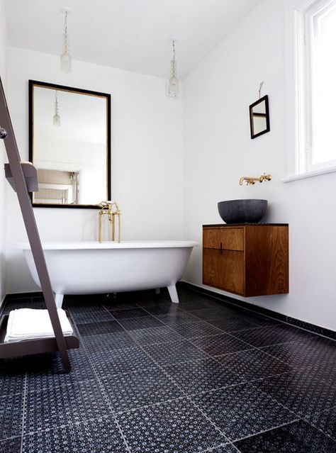 simple modern bathroom with the floor tiles made by made a mano