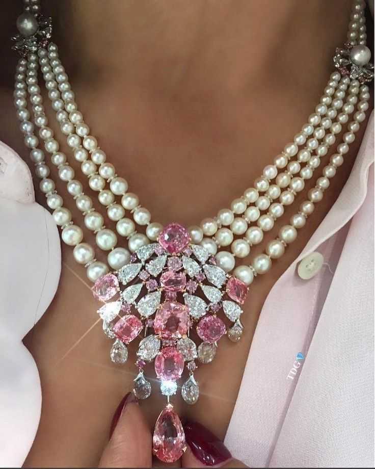 DAVID MORRIS (@davidmorrisjeweller) on Instagram: Padparadscha sapphires, named after the colour of lotus blossom, the pink and orange radiance of these stones is mesmerising. Mixed together with white and pink diamonds, these stones make up a beautiful detachable broach from a flawless necklace held together by natural white pearls. Photographed by @thediamondsgirl #diamondbroach