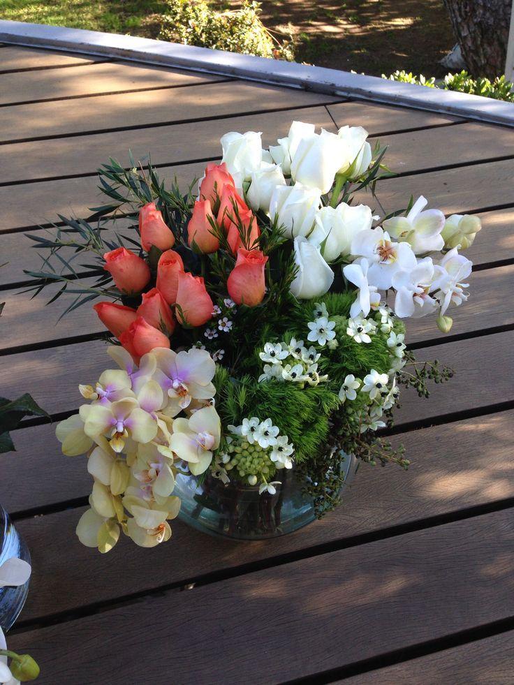 Roses and phalenopsis flower arrangement tangerine white and yellow... Lovely