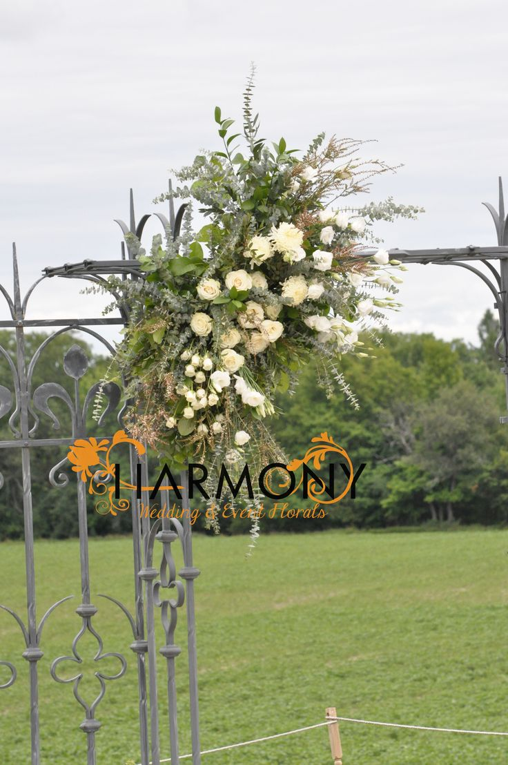 Arbour decor #white #roses #lisianthus #dahlias