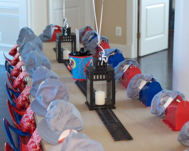 Thomas the Train birthday party maybe! What an AMAZINGLY cute idea. I cannot love the train conductor hats at each childs place setting anymore. LOVE this!!