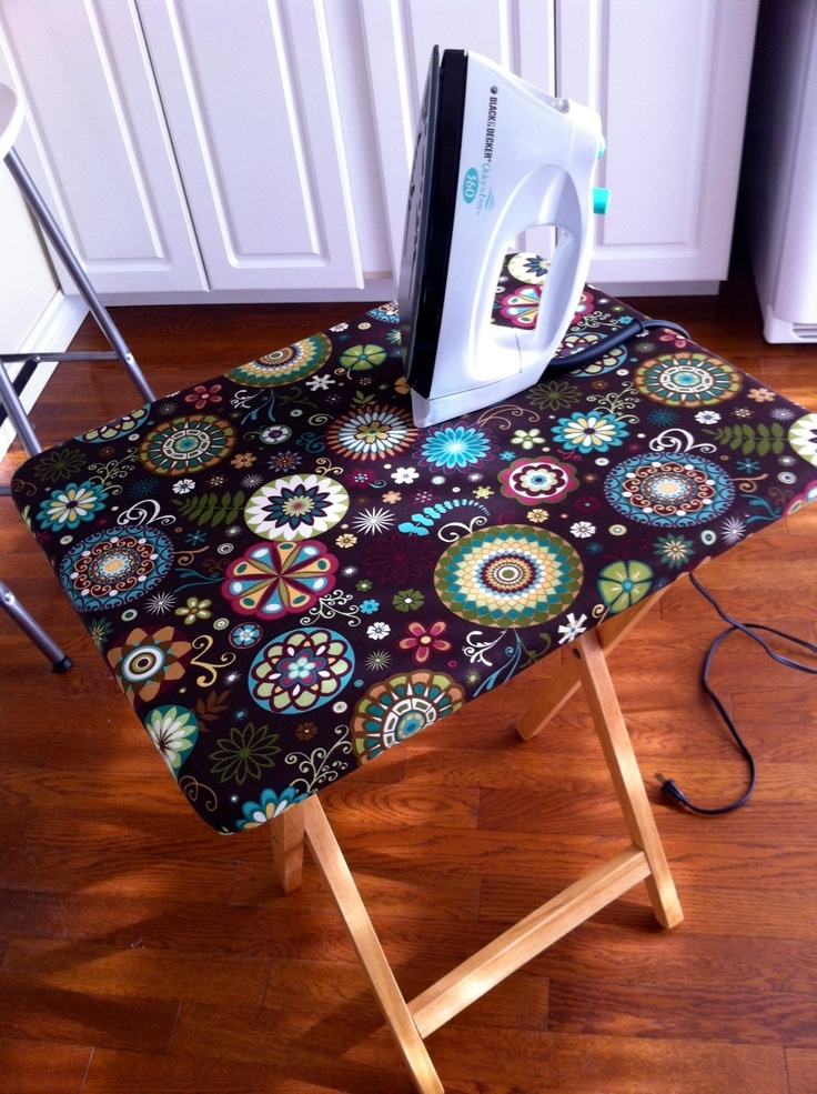 I simply stapled a towel to an old wooden T.V. tray, cut off the excess and then did the same with some scrap fabric!