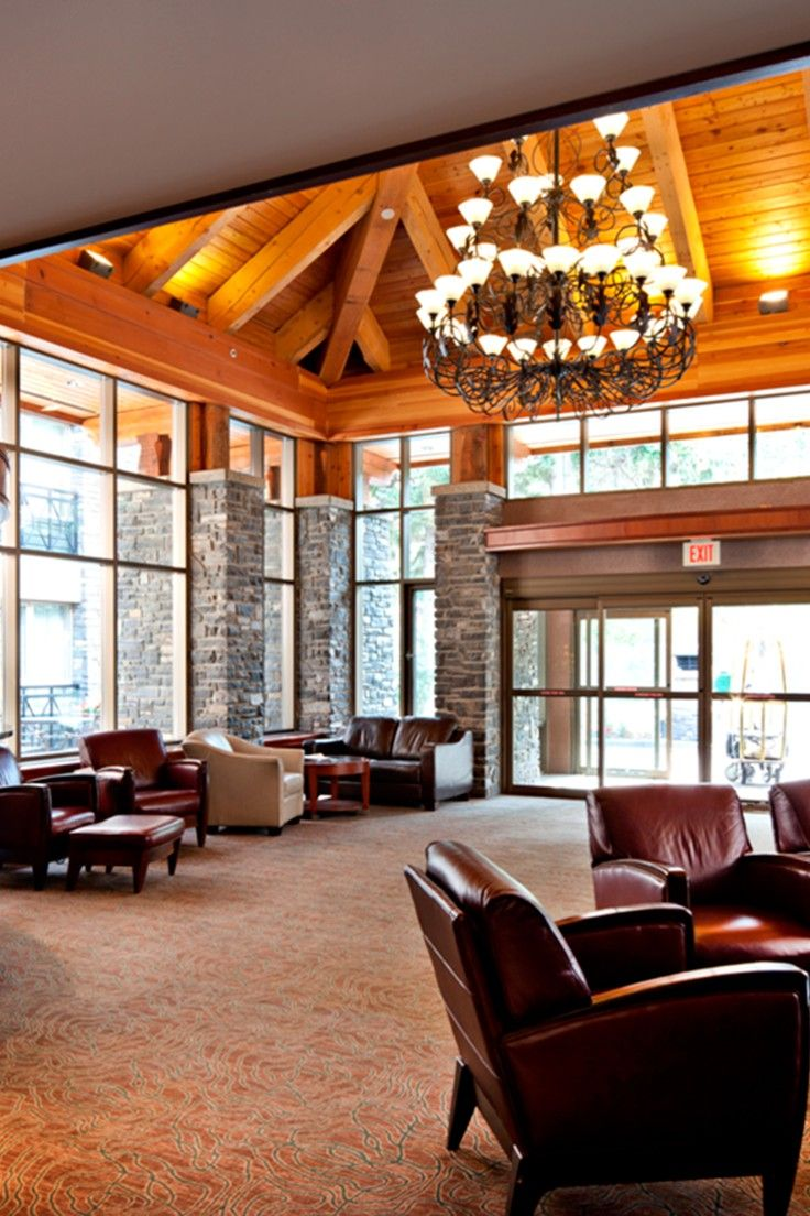 Delta Banff Royal Canadian Lodge - Banff, Canada - The lobby i designed with natural stone walls and woodsy beamed ceilings.