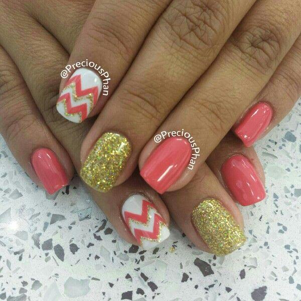 Gold, coral chevron nails