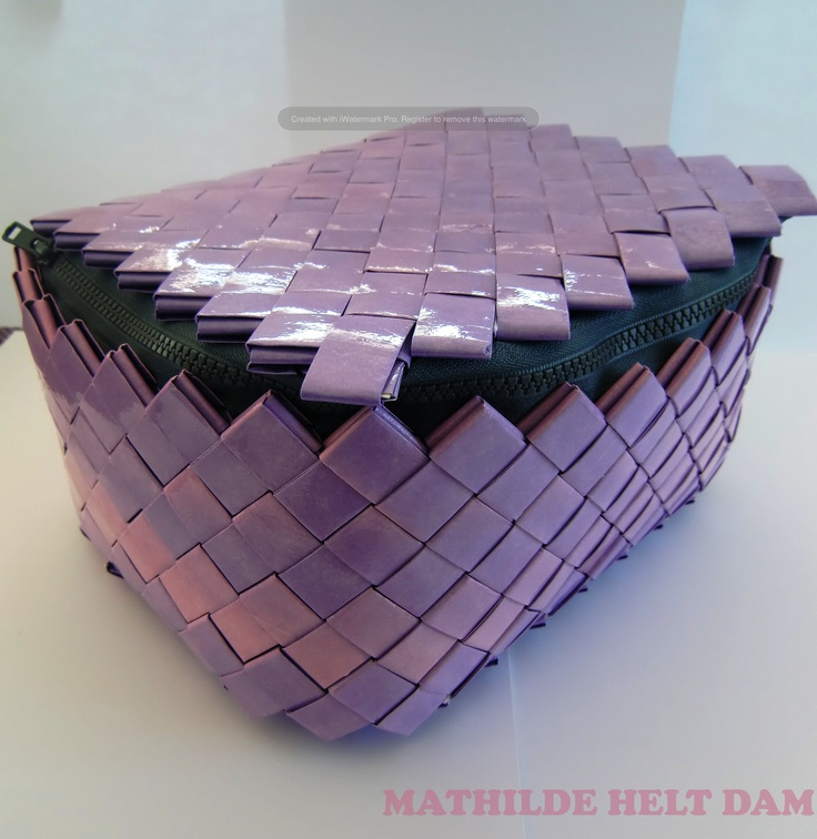"""Bag (beautibox or other) made from insides of used envelopes and clear tape. Technique known as """"candy wrapper crafts""""."""