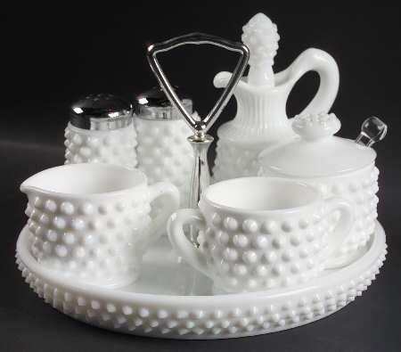 Milk Glass: Hobnail handled tray holding a mini sugar and creamer, salt shakers, cruet, and mustard pot.