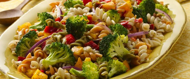 Add pizzazz to a foolproof pasta salad, using crisp and colorful bell peppers, broccoli and onion.