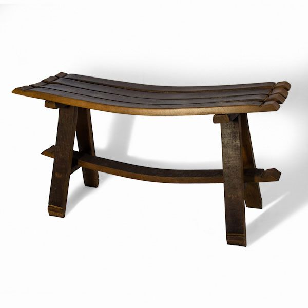 Made from oak wine barrel staves, this original bench is a perfect decorative piece for  gardens or those places you want to add a rustic or traditional touch.