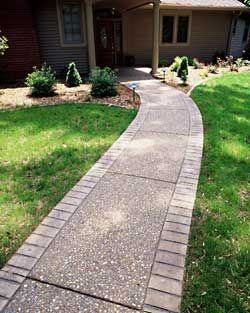 Walkway ideas: Concrete with aggregates, and a stamped brick pattern outer edge