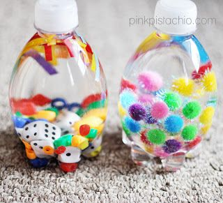 Sensory bottles. Fill a bottle with water and things like pom poms, glitter, dice, ribbon etc