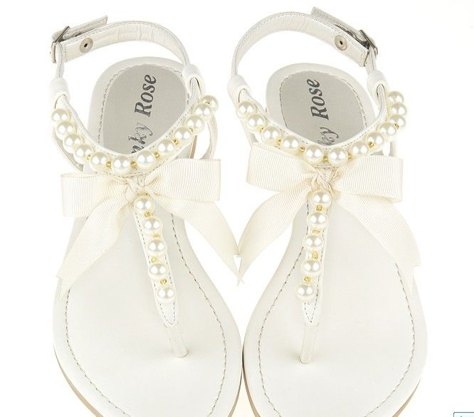 Pearl string white bow sandals perfect for a beach/destination wedding; even after a long night at any other wedding really.