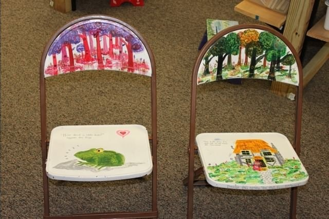 Old folding chairs can be repurposed for classroom use with a little paint and decoration with favorite children's literature scenes and characters.