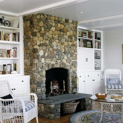 River rock fireplace with built-ins on either side. Exactly what I want, only stained, not painted white.