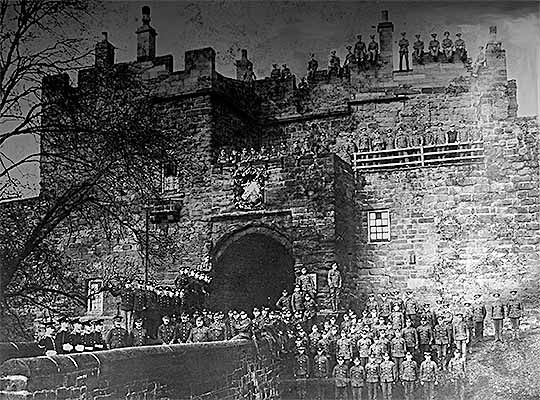 Depot staff and soldiers of the Border Regiment at Carlisle Castle gate on 28 October 1911, the 100th anniversary of the British victory over France at the battle of Arroyo des Molinos in the Peninsular War