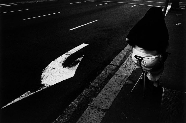 Trent Parke, Magnum Photos AUSTRALIA. Sydney. A nun waits for a cab in the city centre. From Dream/Life series. 1999.