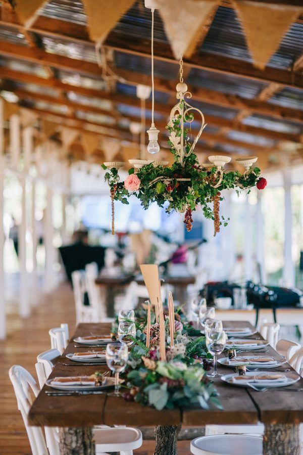 Chandelier draped with flowers | Image by Green Antlers Photography