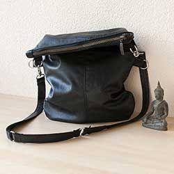 Handgemaakte fold over tas van hergebruikt leer