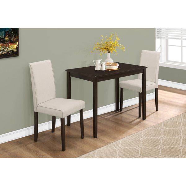 This casual Dashiell 3 Piece Dining Set offers a classic styling that will complement any decor. Perfect for small spaces, the rectangle dining table features an ample surface area with solid wood legs. The comfortably padded Parsons dining chairs are upholstered in an elegant and durable beige linen material. The simple lines of this dining set enveloped with a rich cappuccino finish create a timeless look that you will love.