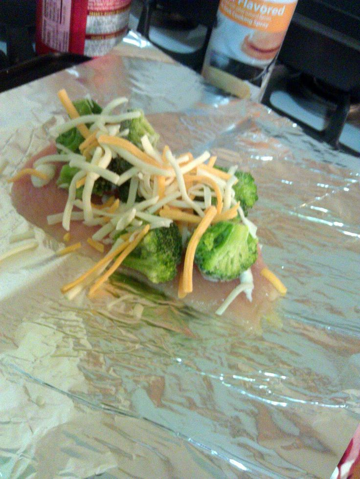 Broccoli, Cheese and Ranch chicken foil packs.. LOVED IT! Made with half a boneless skinnless chicken breast, 1 tsp ranch mix (half on chicken half on broccoli), a bunch a broccoli and 1/8 a cup grated cheese. Baked at 400 for about 45 minutes (chicken was still a tad frozen).