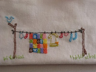 Beautiful simple embroidery. this would be super cute in the laundry room!