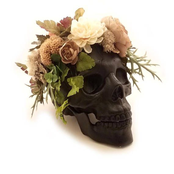 Halloween is my favorite time of year! So much so, that I made this skull centerpiece so I could keep it in my home year round! I hand painted the skull in matte black (Skull is plastic so super lightweight) and choose an assortment of faux silk flowers and real moss. Floral shades are dusty pinks with sage green accents. Since some of the plants are real, handle carefully!  Measures about 8 in diameter. Ships USPS priority mail.