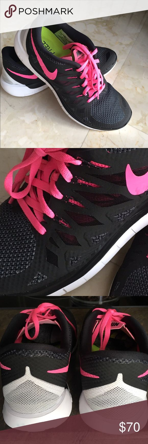 """Nike Free Flyknit 5.0. Sneakers Black and fucshia pink. Worn 3x. Did not sweat in them and no foot odor.  No toe scuffs or heel wear. Nike sneakers tend to run small so these size 11's will comfortably fit a size 10-10.5"""" foot. If you normally wear a size 11, these will fit your feet exact, leaving no room for wearing socks with them. Nike Shoes Athletic Shoes"""