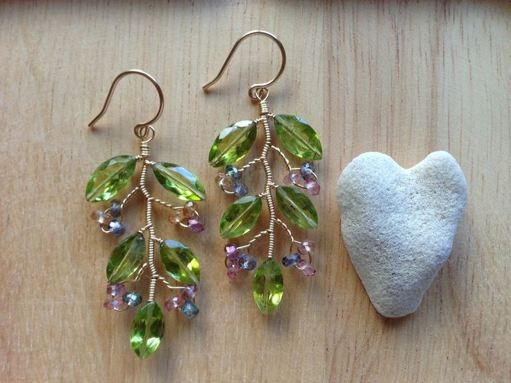 """Peridot, Mystic Quartz, 14kGF wire1.5"""" longMy classic vine earrings in vibrant green and multicolored quartz. Perfect for that August baby or anyone that loves green and the verdant beauty of Hawaii.Designed and refined by Rhoda JFree Shipping for orders over $75. See Sales/Events for more details!"""