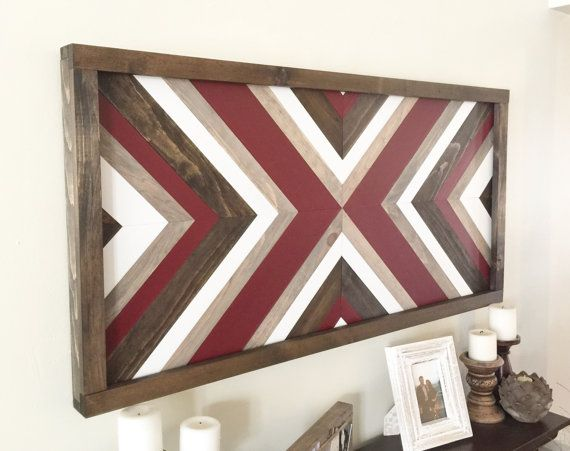 This is a wooden wall piece that has been hand cut, stained, and painted to form a beautiful focal point for any space. It is done in rustic maroons, browns, and greys, giving it the perfect charm with subtle but unique characteristics. We accept custom color and dimension requests so please message us for details. For certain custom requests, an additional fee may apply. Dimensions: approximately 24 X 48 Color combos in order of appearance: 1) maroon accent 2) rustic red accent 3) gray…