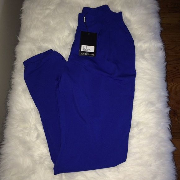 Electric Blue Pants by Missguided NWT Cute electric blue pants by Missguided. Side zipper entry and elastic-banded ankles. Pants have pockets and are perfect pop of blue! US size 6 Missguided Pants